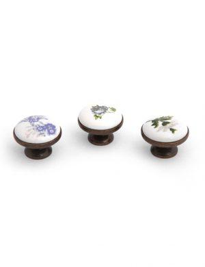 Buton ceramic cu finisaj din bronz.